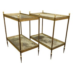Jansen Neoclassical Brass Two-Tiered Side Tables with Églomisé Tops