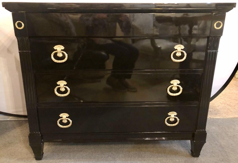 Maison Jansen Style Hollywood Regency Ebony Commodes, Chests or Nightstands. A Pair of the finest finish commodes anyone could ask for. The Steinway finished black lacquered tops supported by a group of four drawers drawers the top with hidden pulls