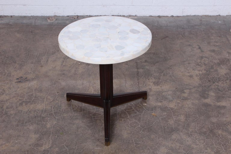 A stone top Janus side table with mahogany and brass base. Designed by Edward Wormley for Dunbar.