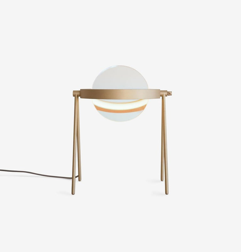 Janus — the name of one of Saturn's outermost rings, as well as the two-faced, coin-gracing Roman deity of transitions — is the inspiration for Trueing's newest table lamp. With an adjustable shade of dichroic glass at its center, the lamp's