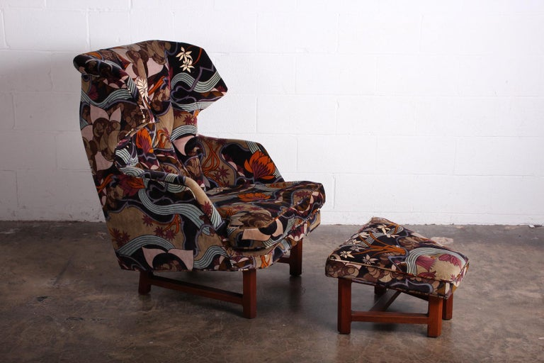 A Janus wing chair and ottoman designed by Edward Wormley for Dunbar in Jack Lenor Larsen Fabric.