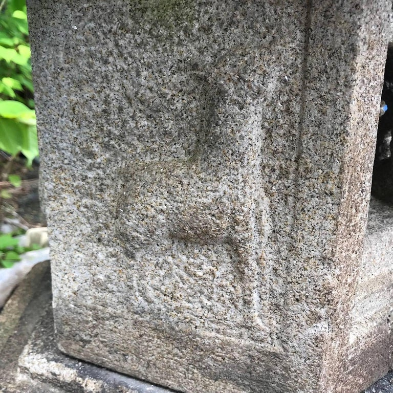 An antique beauty with all original pieces.  Japan, a fine tall kasuga -deer-granite stone lantern with beautifully engraved designs including a deer on its firebox, six pieces.  Dimensions: 78 inches tall and 29 inches diameter, six