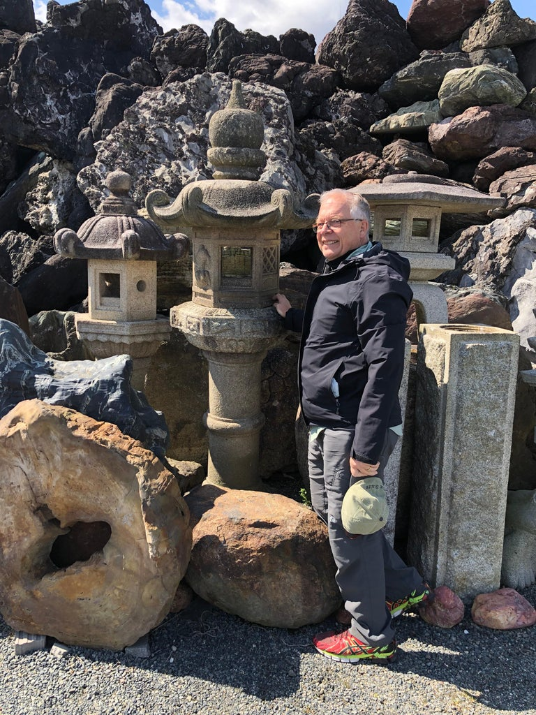 From Our Recent Japanese Acquisitons Travels  An antique beauty depicting the 12 signs of zodiac, tiger, & mountains  Japan, a fine tall kasuga granite stone lantern with a beautifully carved lotus top and finial and with a seldom scene motif of 12