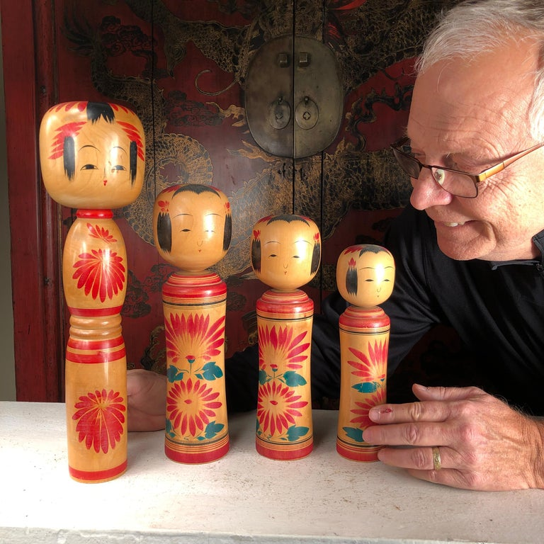 Four big hand painted and signed Kokeshi Dolls from Old Japan.  A beautifully preserved set of Japanese Folk Art hand carved and hand painted Kokeshi dolls one of Japan's most popular antique doll collectibles and unique handicraft forms. They are