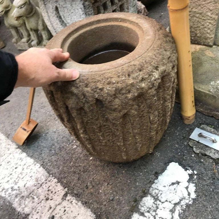 Japan a fine old hand-carved stone tsukubai water basin or planter, Taisho period (1915).  Dimensions: 13 inches tall and 12 inches diameter  Stone tsukubai water basins were originally installed in tea gardens and in a purposely
