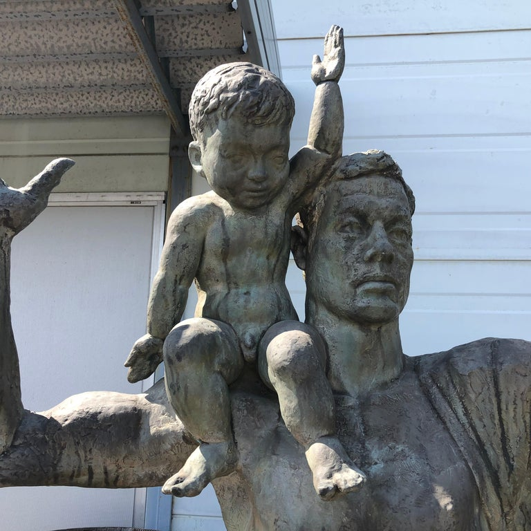 Japan an important life-size plus sculpture of a man with child by Mid-Century Modern master sculptor Koga Tadao, (Meiji 36 (1903) to Showa 54 (1979).   The coming generation proclaims an important event or philosophy or simply a joint announcement,