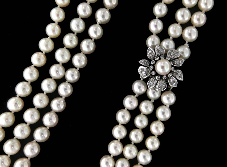 Multi-strand japan pearls bead necklace composed of three strands beads. Antique Clasp white gold 18 karat with diamonds  Necklace weight 129 grams Pearls bead size 7 mm