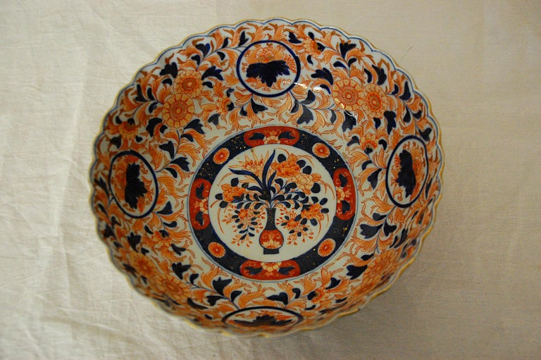 Japanese 19th century Imari 11 inch fluted bowl by the maker Koransha. This impressive bowl is marked with Koransha's blue mountain mark and exemplifies the fine quality of Koransha's potters and painters. It is painted in underglaze blue and