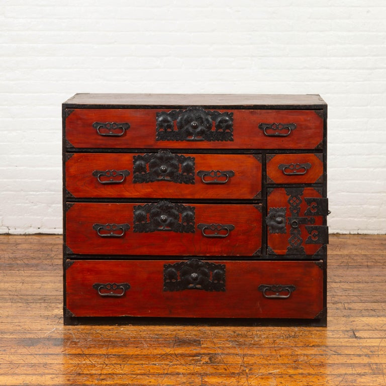 A Japanese 19th century Sendai tansu (Isho-dansu) clothing cabinet with drawers and elaborate bronze hardware. Born in Japan during the 19th century, this wooden Tansu chest is a fine example of Japan's traditional cabinetry. Featuring a lovely