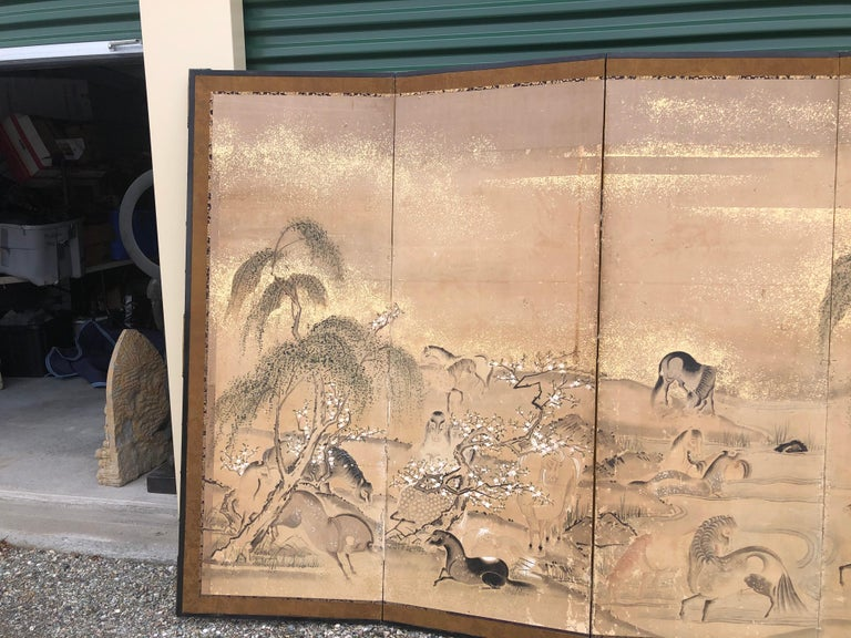 Japan, an early six-panel screen Byobu depicting 20 horses frolicking among mountains and pines. This attractive screen dates to the Edo period, circa 1850.