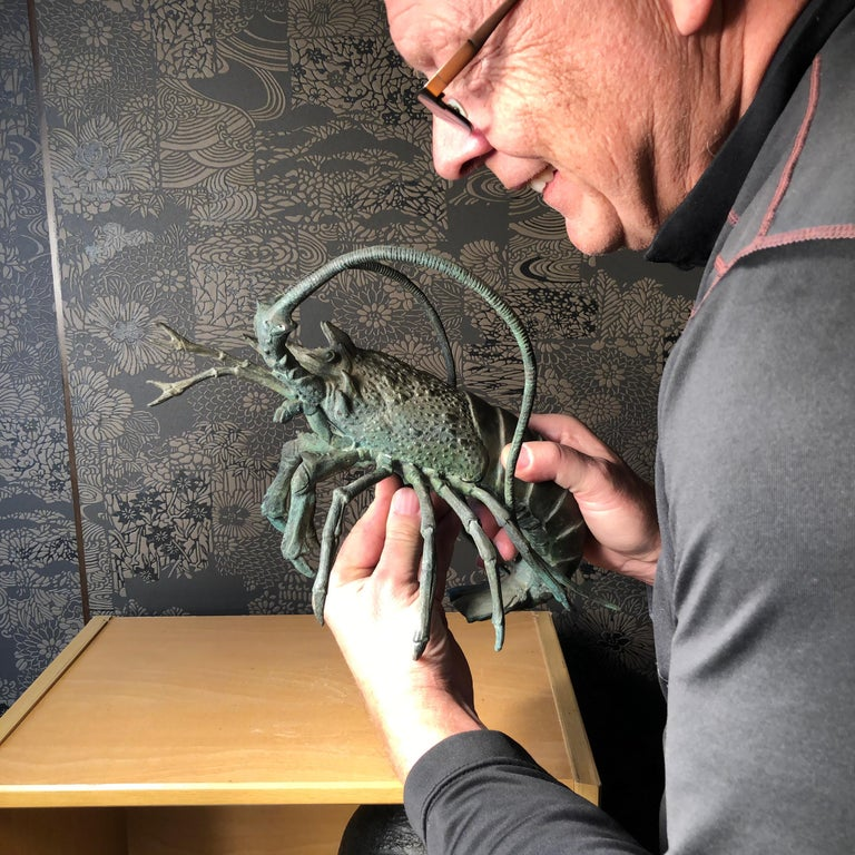 From our recent Japanese acquisitions travels comes this impressive oversized crustacean.  A fine bronze jumbo sculpture okimono of an animated lobster dating to the early 20th century, Taisho period.  Brilliantly conceived with original dark