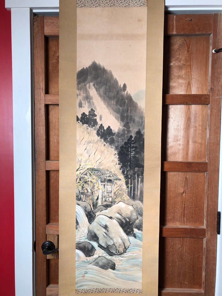 A beautifully executed Japanese vintage hand-printed scroll of an ancient water mill worthy of your favourite room. Hand painting on paper in simple Classic Japanese striking soft pleasing colors, signed.  Signed Ichiro.  Bone rollers.  A