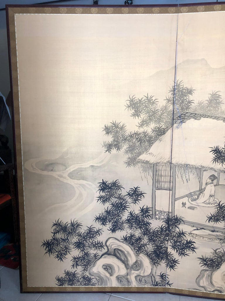Japan, a fine restored two-panel screen Byobu of simple brush strokes on cream ground silk, in a serene, peaceful mood of a scholar among bamboo with mountains plus a serene water fall.   It dates Taisho 7, (1918)   It is signed