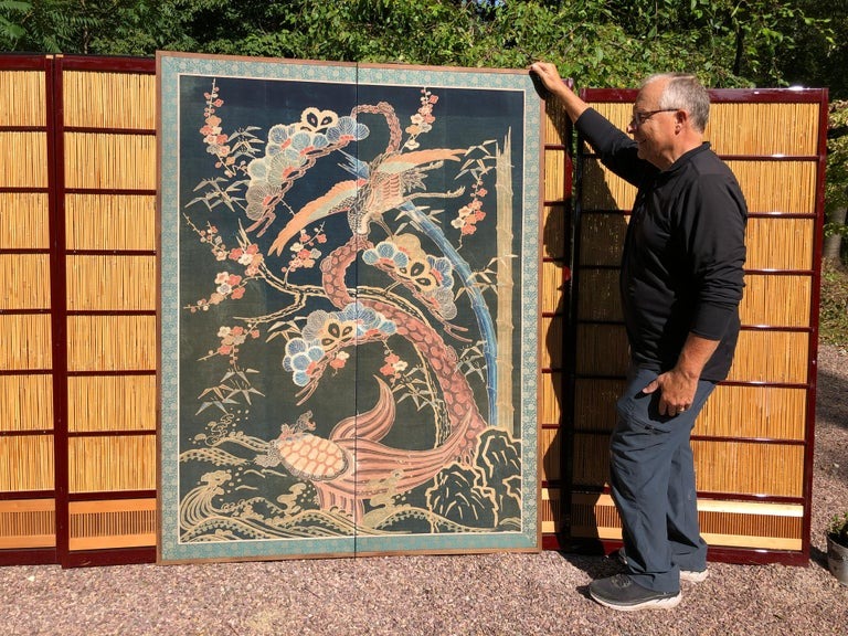 From our recent Japanese acquisitions travels- great wall art  A beautiful two panel screen created from a well-preserved futon cover tsutsugaki made of heavy cotton with the auspicious images of a large phoenix, turtle, sakura, scholar rocks, and