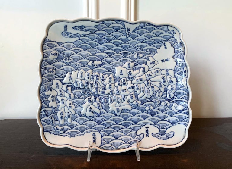 A rectangular form ceramic map plate from Arita, Japan, circa Tenpo years (1830-1844) of late Edo Period. This piece of unusual blue and white Arita ware features the novel use of maps as underglaze decoration, a phenomena appeared in Japan in the