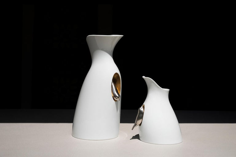 This poetic carafe is designed by GumDesign and handmade in Japan by Risogama for Hands on Design, a traditional pottery. It's characterized by a small silver bird that seems to take refuge in a golden nest carved into the material. The spout for
