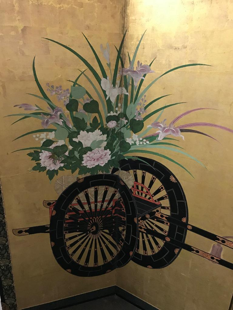 A gorgeous six-panel Japanese Byobu folding screen. Listing as Meiji period but could very possibly Edo period. Decorated with peonies, irises and wisteria, and two traditional flower carts all on gold leaf. The colors still radiate