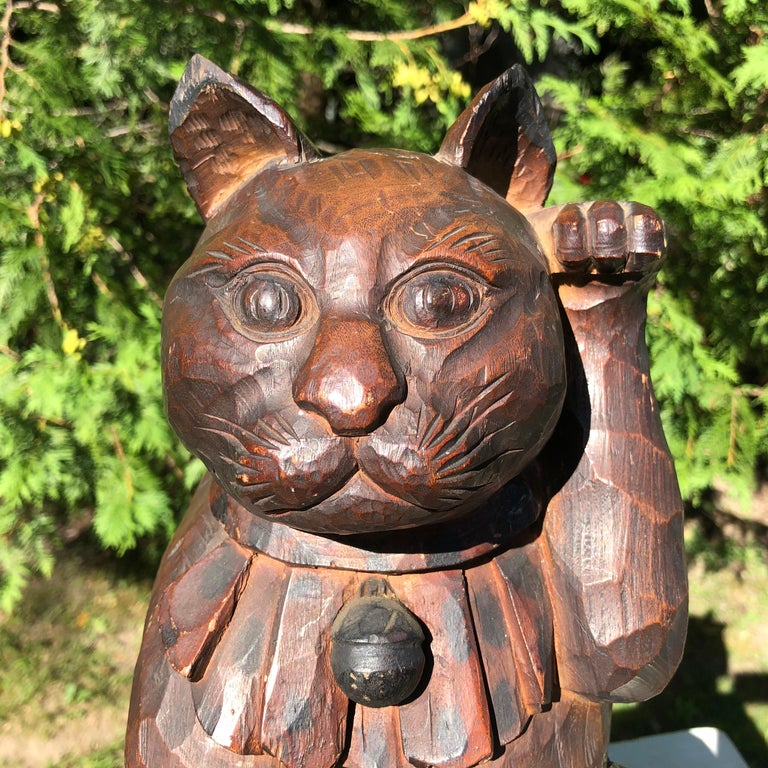Japan a rare large scale and lovely hand carved and hand-lacquered wooden Maneki Neko good fortune money cat. It is exquisitely carved in a Classic Japanese one piece