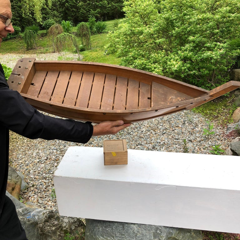 Fresh find from our recent Japanese acquisitions travels  This big old hand carved wooden boat -fune- including a hand fitted wooden slat interior and brass riveted exterior was likely once used decades ago as a flower arranging display vessel -