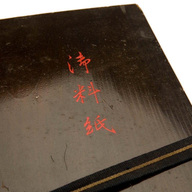 A high quality, antique, Japanese black lacquer document box. It has an external design of gold maki e plum blossoms. In Japanese culture plum blossom symbolises the beginning of Spring, having its own festival, the Ume Matsuri, alongside the more