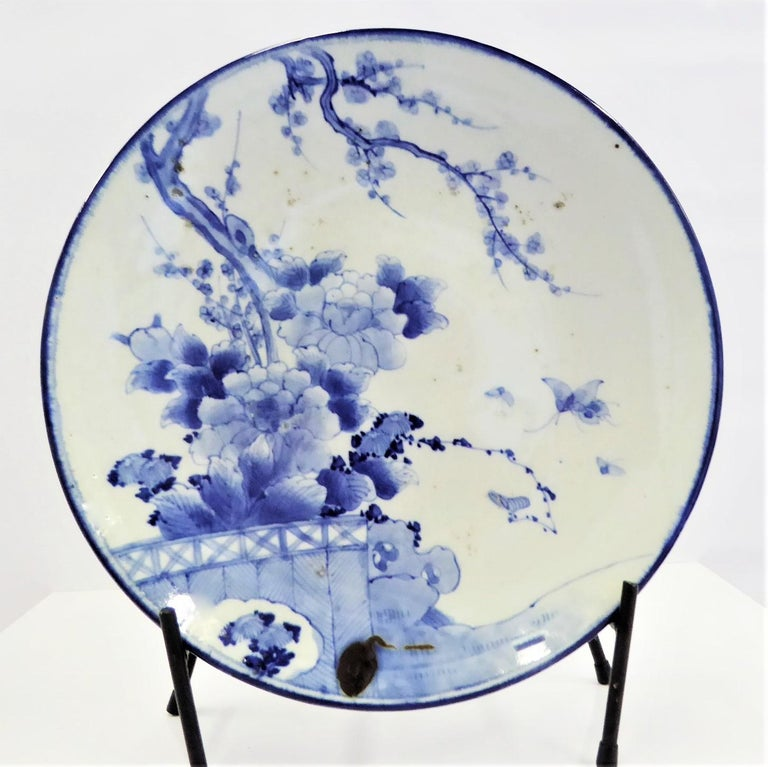 Large and lovely Japanese blue and white Arita porcelain charger from the early 20th century. The symbolism of this Charger is very spiritual. It is decorated with Cherry Blossoms (Sakura), meaning time of renewal but also symbolic for the fleeting