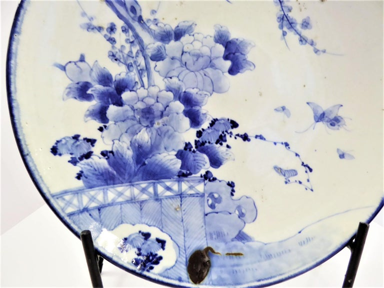 Glazed Japanese Blue and White Arita Charger with Butterflies, Peonies and Sakura For Sale