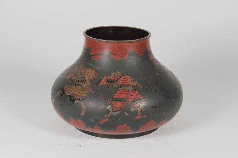 "Japanese brass inlaid Meiji period bowl depicting Samurai warriors. Dimensions: 13"" diameter x 9"" height."