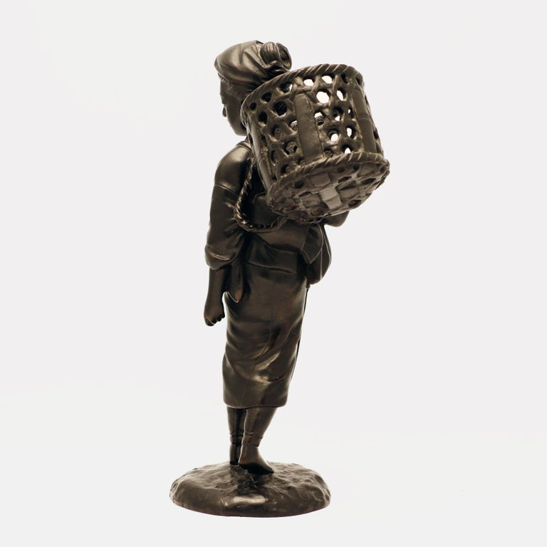 Meiji Japanese Bronze Figure, a Peasant Girl with a Wicker Basket For Sale