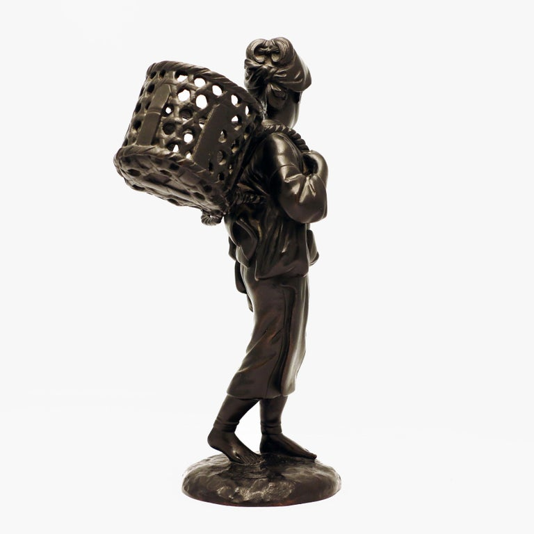 Cast Japanese Bronze Figure, a Peasant Girl with a Wicker Basket For Sale