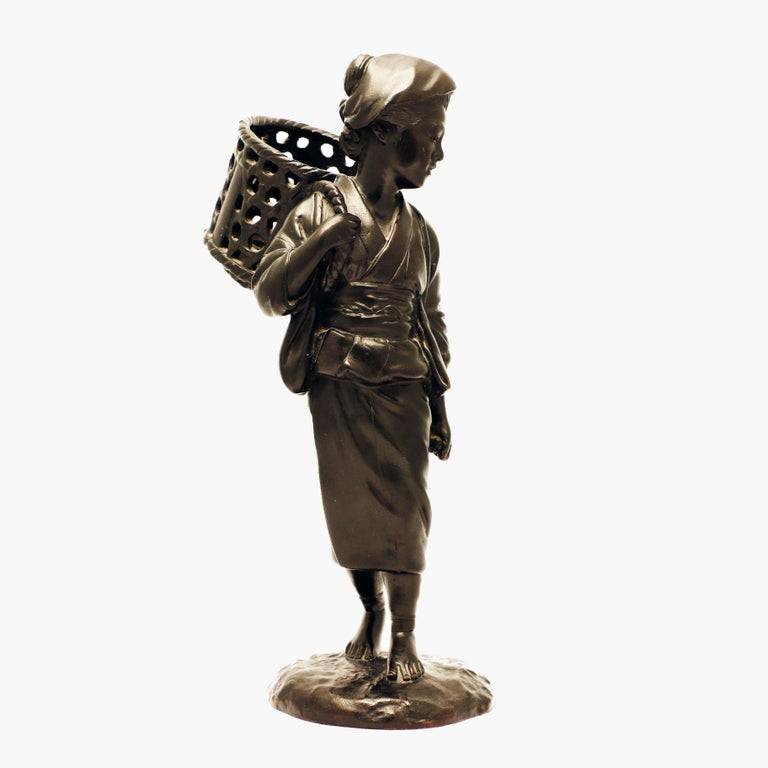 Japanese Bronze Figure, a Peasant Girl with a Wicker Basket In Good Condition For Sale In Montreal, QC