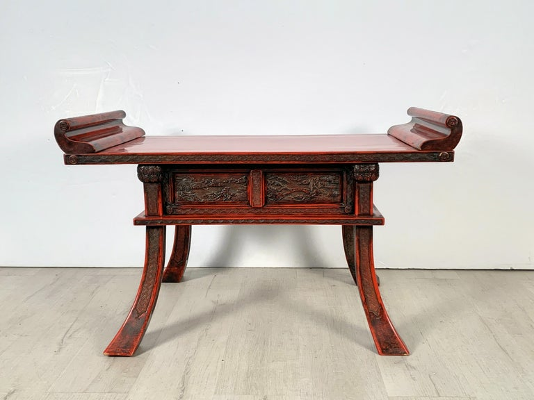 A fine and rare Japanese Kamakura-bori carved and red lacquered Buddhist altar table, Edo to Meiji period, mid-19th century, Japan.  The Buddhist altar table of typical form, with dramatic flared legs that taper elegantly upwards to support a high