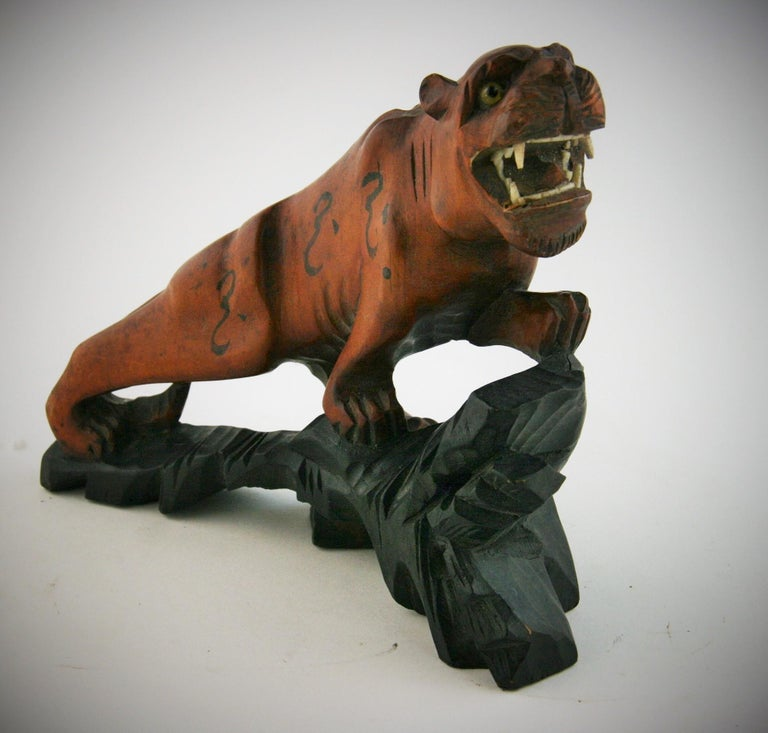 8-241 Japanese hand carved boxwood tiger with glass eyes and fanged teeth.