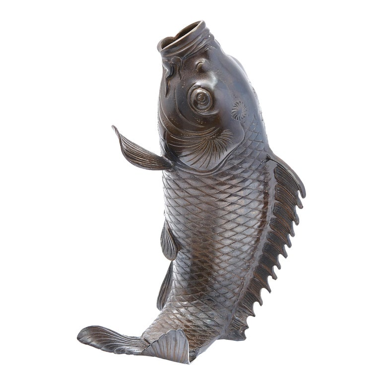 Japanese cast bronze vase in the form of a carp, mid-20th century. Realistic in form, with cross hatch scales, the mouth open to form a vase.