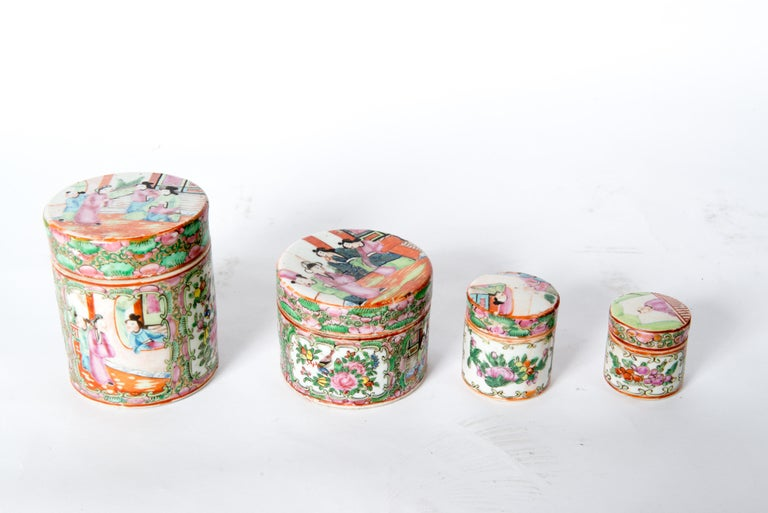 Set of four Japanese lidded porcelain jars. Second jar is 3.75 diameter, 3 high. Third jar is 2.25 diameter, 2.5 high. Fourth jar is 2 diameter, 2 high.  The lid to the second largest jar is damaged. There is a piece missing on the rim.