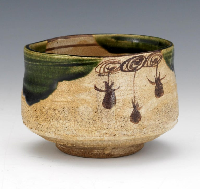 A Japanese ceramic tea bowl known as chawan potted in the E-Oribe style (painted Oribe). Oribe is a Sub type of high-fired Mino wares produced in the Seto and Mino areas of Gifu Prefecture in Japan. Mino ware was originated in the late 16th century