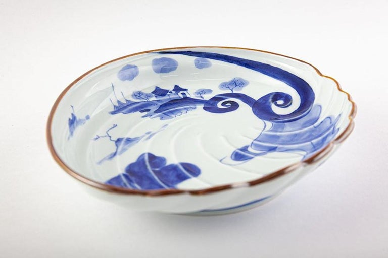 Contemporary Japanese Ko-Imari (old Imari) style charger in blue and white on a stunning abalone shape porcelain body, crafted and signed by renowned Kiln of the Imari-Arita region of southern Japan, and is inspired by shapes and designs popularized