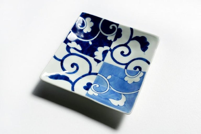 Japanese contemporary porcelain dessert/fruit/bread plate in an elegant square shape, hand-painted in blue underglaze in cobalt and light blue to showcase a graceful arabesque or karakusa pattern. The artist's signature appears on the reverse side.