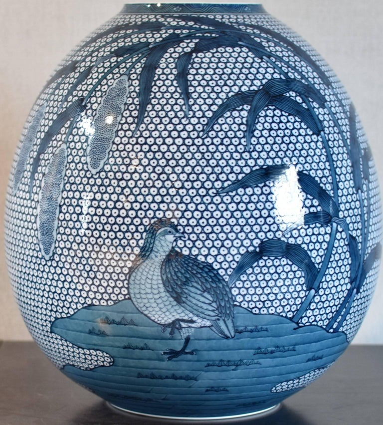 """Contemporary decorative ceramic vase in blue underglaze on a beautifully shaped body by a highly acclaimed award-winning master porcelain artist of the Imari-Arita region of Japan. The traditional """"quail and millet"""" motif symbolizing bountiful"""