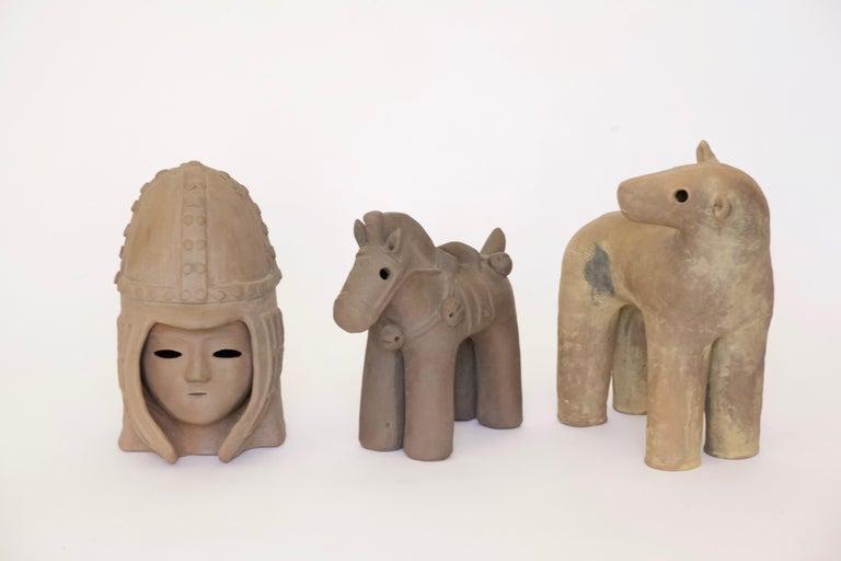 3 ceramic Japanese Haniwa style ceramic figures.