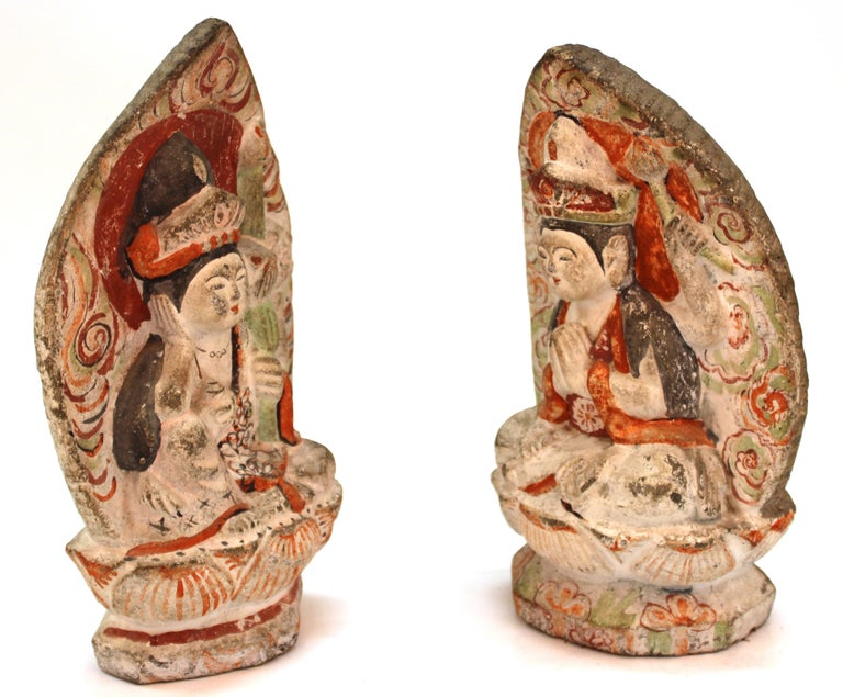 Japanese Edo period pair of carved stone female Bodhisattva sculptures, hand painted. The pair has incised markings on their backs and was made in circa 1750 in Japan. In great antique condition with age-appropriate wear to the material and paint.