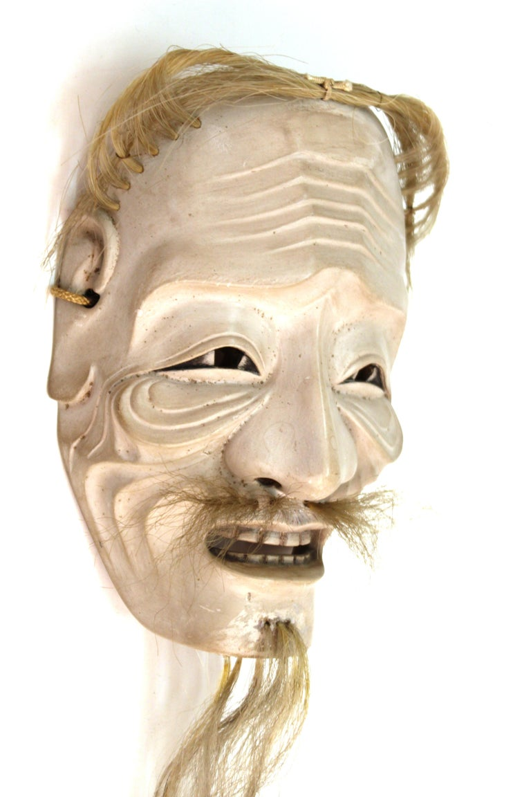 Japanese Edo period carved wood mask depicting Ko-Jo, an old man. The piece dates to circa 1820 and is in great condition. 15 inches long with the beard.