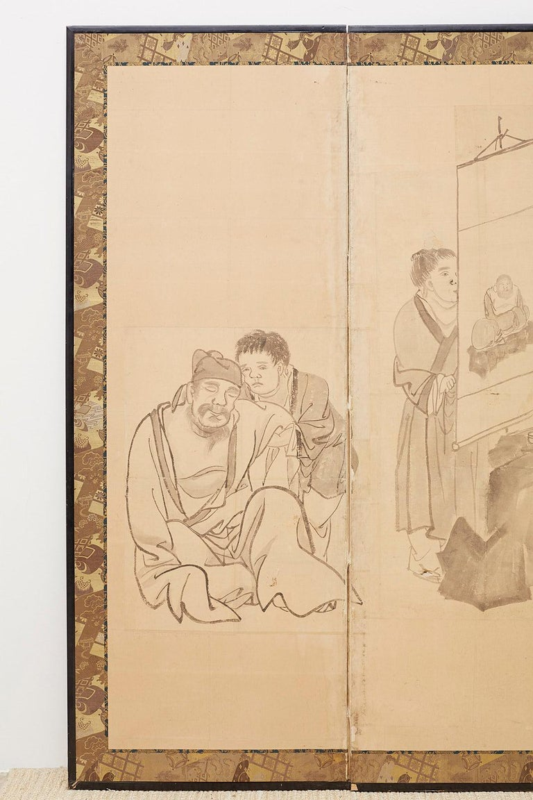 Fascinating 19th century Japanese late Edo period six pane funpon screen. Large scale depicting Chinese scholars and officials engaged in leisurely persuits. Ink on hand-crafted textured paper made in the Maruyama-Shijo School style. Interesting