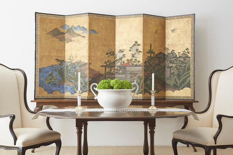 18th century Japanese Edo period six-panel screen featuring summer foliage landscape with birds along a woven fence. Kano school ink and color pigments over squares of gold leaf with interesting texture and geometric patterns on the painted fence.