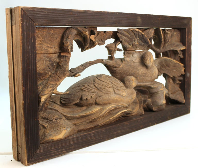 Japanese Edo period wooden temple carving with two doves in branches. The scene is set into a frame that suggests the piece having been initially part of a building element or a furniture piece. Dates to the 17th century.