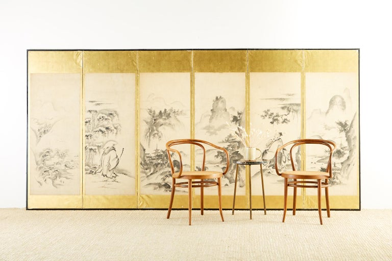 19th century Japanese Edo period six-panel screen painted in Haboku (splashed ink) style. Depicts Four Seasons landscape scenes with two portraits of Chinese sages. One sage is traveling in the snow, the other is with a crane. Kano school ink on