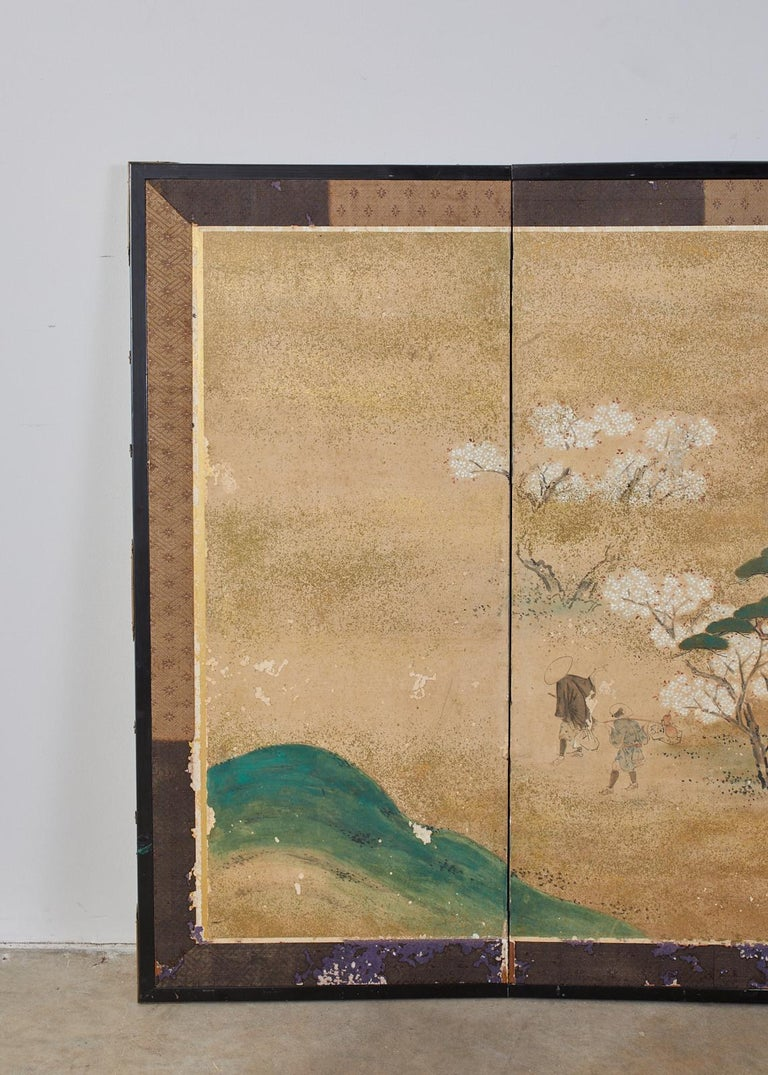 Colorful 18th century Japanese Edo period six-panel screen of a flower viewing party. Made in the Maruyama- Shijo school influence. Features figures feasting under flowering cherry Sakura trees. Proverb