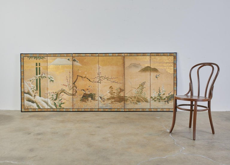 Early 18th century Japanese Edo period six-panel screen depicting a seasonal winter landscape. The idyllic scene features ducks and birds with flowers of fall and winter by water's edge. Beautifully crafted with ink and natural color pigments on