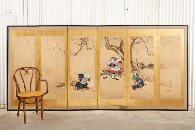Spectacular 19th century Japanese late Edo period six-panel byobu screen depicting Yoshitsune and Benkei, two heroes of Japanese folklore. Crafted in ink and natural color pigments on mulberry paper with thick gold leaf borders on each panel. The