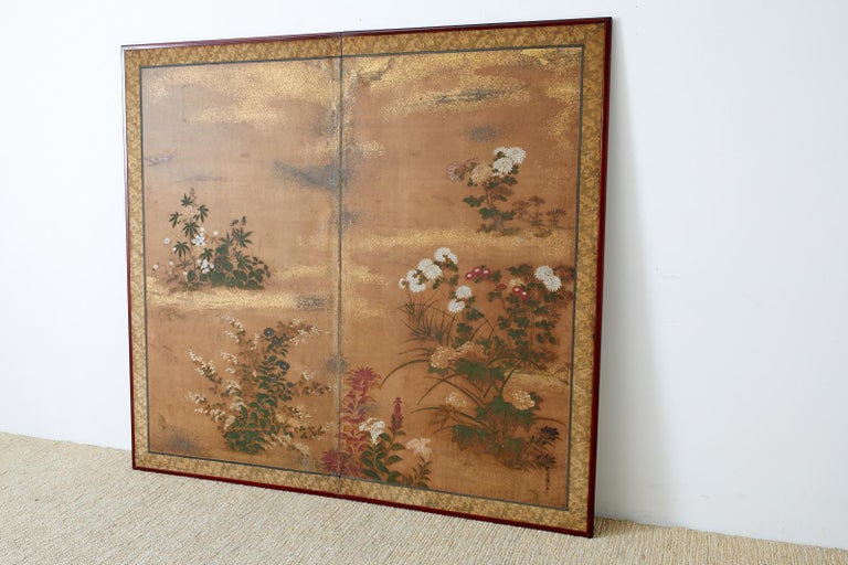 Impressive early 19th century Japanese Edo period two-panel screen featuring flowering plants and grasses of autumn. Painted in the Tosa School style Bunka Bunsei period or Ogosho period (1804-1829) signed Juroki-i-jo (upper junior sixth rank)