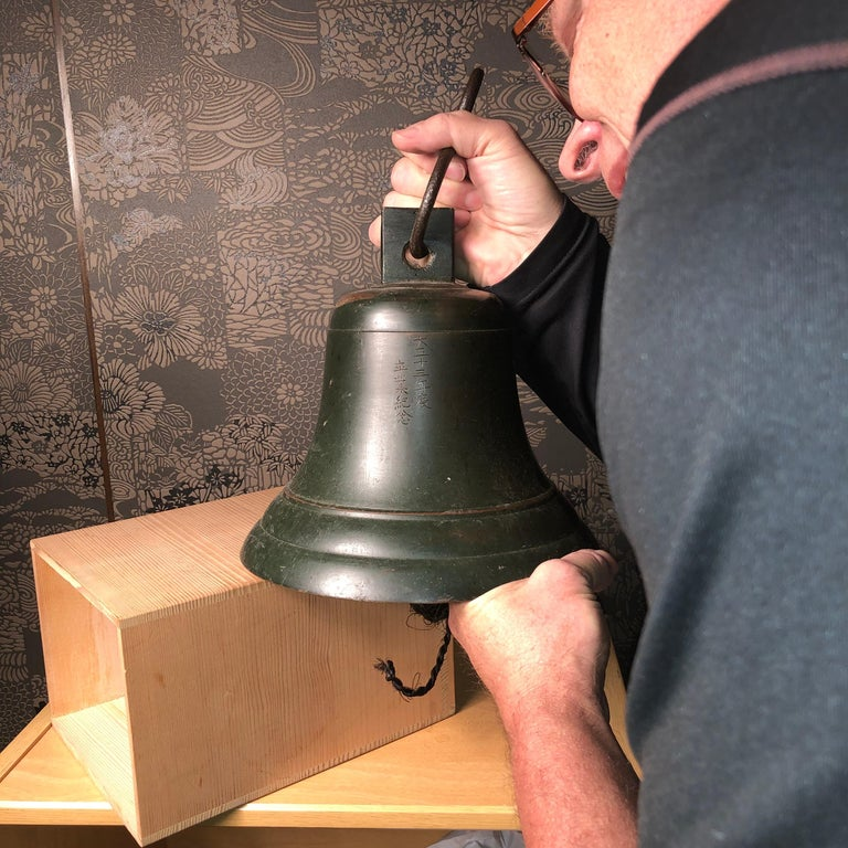 From our recent Japanese Kyoto Acqusitions- good indoor or garden candidate.  An unusual find from Japan.  This is a heavy and solid ships bell dated to Taisho 13, 1924. Cast in solid bronze complete with hanger and clapper.   We do not find